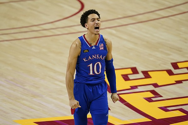 Kansas forward Jalen Wilson celebrates after making a 3-point basket during the second half of an NCAA college basketball game against Iowa State, Saturday, Feb. 13, 2021, in Ames, Iowa. Kansas won 64-50. (AP Photo/Charlie Neibergall)