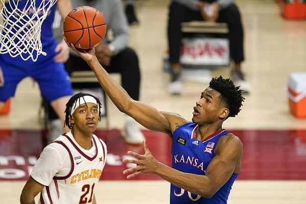 Kansas guard Ochai Agbaji drives to the basket in front of Iowa State guard Jaden Walker, left, during the second half of an NCAA college basketball game, Saturday, Feb. 13, 2021, in Ames, Iowa. Kansas won 64-50. (AP Photo/Charlie Neibergall)