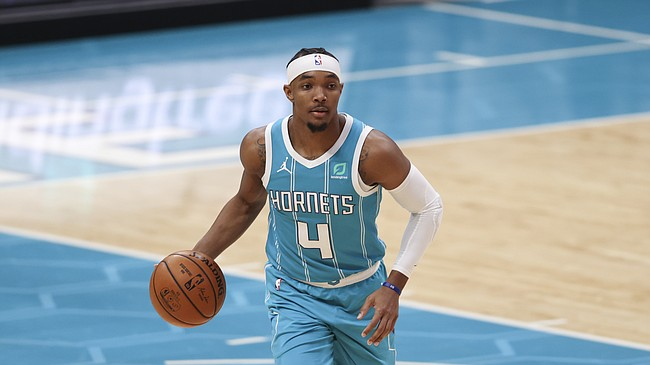 Charlotte Hornets guard Devonte' Graham brings the ball up court against the Minnesota Timberwolves during the second half of an NBA basketball game in Charlotte, N.C., Friday, Feb. 12, 2021. Charlotte won 120-114. (AP Photo/Nell Redmond)