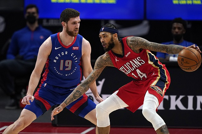New Orleans Pelicans forward Brandon Ingram (14) controls the ball as Detroit Pistons guard Svi Mykhailiuk (19) defends during the second half of an NBA basketball game, Sunday, Feb. 14, 2021, in Detroit. (AP Photo/Carlos Osorio)