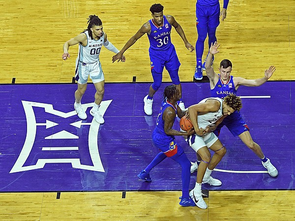 Kansas senior Marcus Garrett helps rip the ball away during a game against K-State at Bramlage Coliseum in Manhattan, Kansas on February 17, 2021.