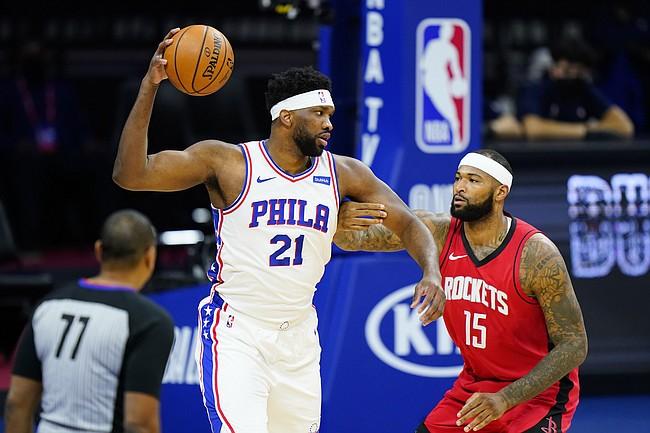 Philadelphia 76ers' Joel Embiid (21) tries to get past Houston Rockets' DeMarcus Cousins (15) during the first half of an NBA basketball game, Wednesday, Feb. 17, 2021, in Philadelphia. (AP Photo/Matt Slocum)