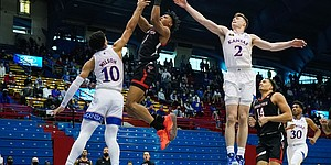 Texas Tech guard Terrence Shannon Jr. (1) shoots against Kansas forward Jalen Wilson (10) and guard Christian Braun (2) during the second half at Allen Fieldhouse Saturday afternoon in Allen Fieldhouse on Feb. 20, 2021. Photo by Jay Biggerstaff-USA TODAY Sports.