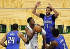 Detroit Pistons guard Josh Jackson (20) tries to score as Orlando Magic forward Al-Farouq Aminu (2), guard Michael Carter-Williams (7), and center Khem Birch (24) defend in the first half during an NBA basketball game, Sunday, Feb. 21, 2021, in Orlando, Fla. (AP Photo/Joe Skipper)