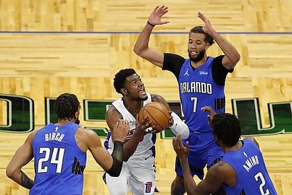 Detroit Pistons guard Josh Jackson (20) tries to score as Orlando Magic forward Al-Farouq Aminu (2), guard Michael Carter-Williams (7), and center Khem Birch (24) defend in the first half during an NBA basketball game, Sunday, Feb. 21, 2021, in Orlando, Fla. (AP Photo/Joe Skipper)