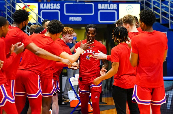 Teammates of Kansas guard Marcus Garrett congratulate him as he is brought out to the court prior to tipoff on Senior Night, Saturday, Feb. 27, 2021 at Allen Fieldhouse.