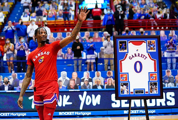 Kansas guard Marcus Garrett waves to the crowd as he is honored before tipoff on Senior Night, Saturday, Feb. 27, 2021 at Allen Fieldhouse.