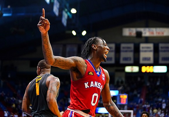 Kansas guard Marcus Garrett (0) celebrates a forced turnover by the Jayhawks late in the second half of the Jayhawks' 71-58 win over Baylor on Saturday, Feb. 27, 2021 at Allen Fieldhouse.