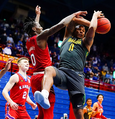 Kansas guard Marcus Garrett (0) pops the ball away from Baylor guard Mark Vital (11) during the second half on Saturday, Feb. 27, 2021 at Allen Fieldhouse.