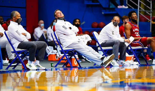 Kansas head coach Bill Self watches the video board as the Bears cut into the Jayhawks' lead during the second half on Saturday, Feb. 27, 2021 at Allen Fieldhouse.