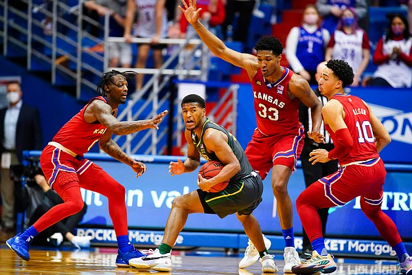 Kansas guard Marcus Garrett (0), Kansas forward David McCormack (33) and Kansas forward Jalen Wilson (10) surround Baylor guard Jared Butler (12) during the first half on Saturday, Feb. 27, 2021 at Allen Fieldhouse.