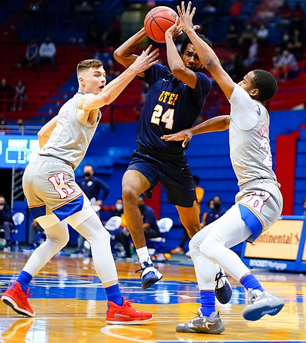 UTEP guard Jamal Bieniemy (24) looks to break through a double team from Kansas guard Christian Braun (2) and Kansas guard Bryce Thompson (24) during the first half on Thursday, March 4, 2021 at Allen Fieldhouse.