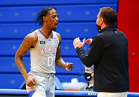 Kansas guard Marcus Garrett (0) and Kansas head coach Bill Self react after being called for a foul during the second half on Thursday, March 4, 2021 at Allen Fieldhouse.
