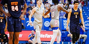 Kansas guard Christian Braun (2) comes to congratulate Kansas guard Marcus Garrett (0) after the Jayhawks pulled off a 67-62, comeback win over UTEP on what would be Garrett's final game at Allen Fieldhouse, Thursday, March 4, 2021.