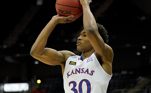 Kansas guard Ochai Agbaji attempts a jumper during the Phillips 66 Big 12 Basketball Championship at the T-Mobile Center in Kansas City, Missouri on March 10, 2021.