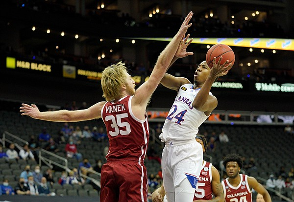 Kansas freshman guard Bryce Thompson goes in for a shot attempt versus Oklahoma's Brady Manek during the Phillips 66 Big 12 Basketball Championship at the T-Mobile Center in Kansas City, Missouri on March 10, 2021.