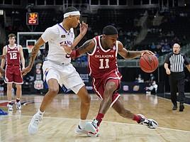 KU freshman Dajuan Harris hounds Oklahoma's De'Vion Harmon during KU's 69-62, Big 12 quarterfinal victory over Oklahoma on Thursday, March 11, 2021, at T-Mobile Center in Kansas City, Mo.