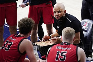 Eastern Washington head coach Shantay Legans talks to his players during the second half of an NCAA college basketball game against Arizona, Saturday, Dec. 5, 2020, in Tucson, Ariz. (AP Photo/Rick Scuteri)