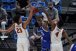 USC forward Max Agbonkpolo (23) and Evan Mobley (4) defend Drake guard D.J. Wilkins (0) during the second half of a men's college basketball game in the first round of the NCAA tournament at Bankers Life Fieldhouse in Indianapolis, Saturday, March 20, 2021. (AP Photo/Paul Sancya)