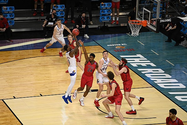 KU senior Marcus Garrett shoots a short shot in the paint during Saturday's 93-84 first-round NCAA Tournament victory over Eastern Washington at Indiana Farmers Coliseum in Indianapolis.