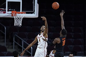 Southern California forward Evan Mobley (4) blocks a shot by Oregon State forward Warith Alatishe (10) during the second half of an NCAA college basketball game Thursday, Jan. 28, 2021, in Los Angeles. (AP Photo/Ashley Landis)