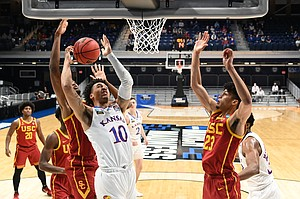 Kansas guard Jalen Wilson goes up inside against the USC Trojans in the second round of the 2021 NCAA Division I Men's Basketball Tournament, at Hinkle Fieldhouse on March 22, 2021, in Indianapolis, Indiana. (Photo by Brett Wilhelm/NCAA Photos via Getty Images)