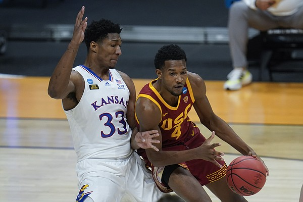 Kansas forward David McCormack (33) guards USC forward Evan Mobley (4) during the first half of a men's college basketball game in the second round of the NCAA tournament at Hinkle Fieldhouse in Indianapolis, Monday, March 22, 2021. (AP Photo/Paul Sancya)