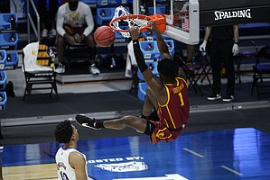USC forward Chevez Goodwin (1) dunks on Kansas forward Jalen Wilson (10) during the second half of a men's college basketball game in the second round of the NCAA tournament at Hinkle Fieldhouse in Indianapolis, Monday, March 22, 2021. (AP Photo/Paul Sancya)