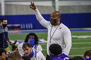 Kansas football interim head coach Emmett Jones addresses the Jayhawks at the team's indoor practice facility on March 30, 2021, the first day of KU's spring practice schedule.