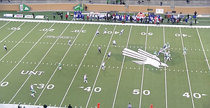 Screen shot of North Texas wide receiver Jaelon Darden waving his hand to signal he's open during a game against Louisiana Tech this past season. Jason Bean, who was the quarterback on this play, has decided to transfer to KU.