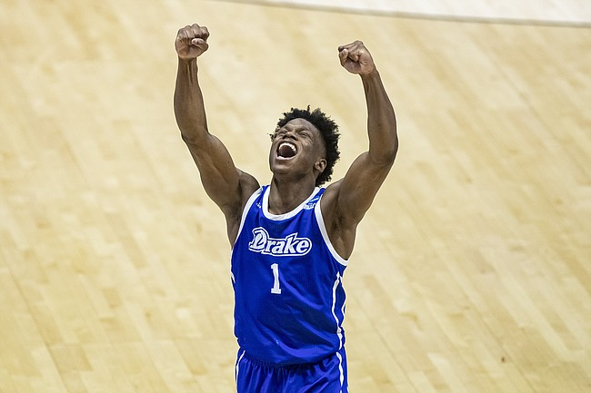 Drake's Joseph Yesufu celebrates late in the second half of a First Four game against Wichita State in the NCAA men's college basketball tournament Thursday, March 18, 2021, at Mackey Arena in West Lafayette, Ind. Drake won 53-52. (AP Photo/Robert Franklin)