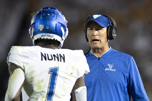 Buffalo head coach Lance Leipold talks with wide receiver Antonio Nunn (1) during the second quarter of an NCAA college football game against Penn State in State College, Pa., on Saturday, Sept. 7, 2019. (AP Photo/Barry Reeger)