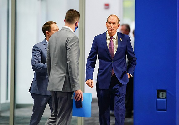 New Kansas head football coach Lance Leipold, right, and athletic director Travis Goff, left, are escorted to an introductory press conference on Monday, May 3, 2021 at the KU football indoor practice facility.