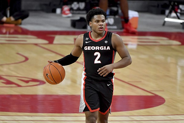 Georgia's Sahvir Wheeler (2) against Arkansas during the first half of an NCAA college basketball game Saturday, Jan. 9, 2021, in Fayetteville, Ark.