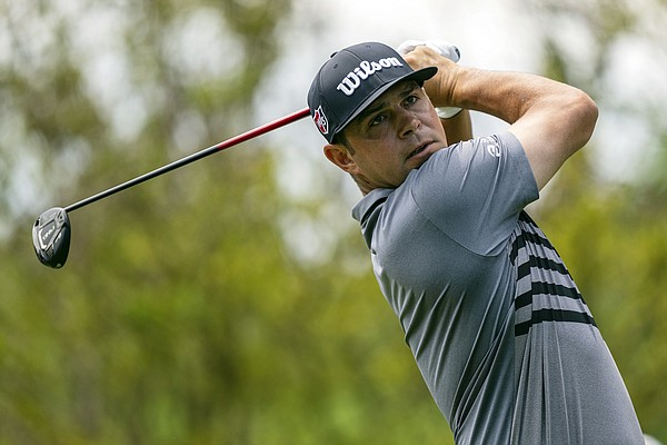 Gary Woodland watches his tee shot on the second hole during the third round of the Wells Fargo Championship golf tournament at Quail Hollow on Saturday, May 8, 2021, in Charlotte, N.C.