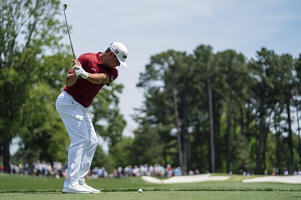 Gary Woodland tees off on the fourth hole during the fourth round of the Wells Fargo Championship golf tournament at Quail Hollow on Sunday, May 9, 2021, in Charlotte, N.C.