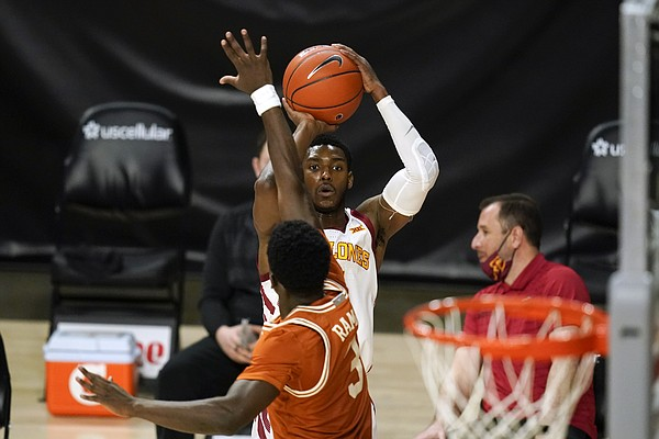 Iowa State Guard Jalen Coleman-Lands shoots a 3-point basket over Texas goalie Courtney Ramey (3) in the second half of an NCAA college basketball game on Tuesday March 2, 2021, in Ames, Iowa.  Texas won 81-67.