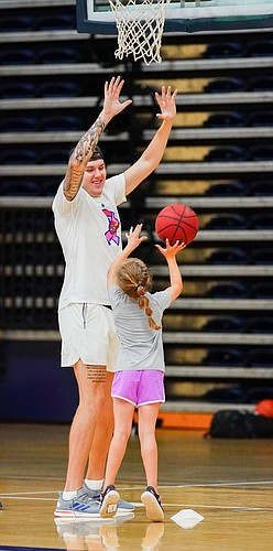 Kansas newcomer Cam Martin puts up some defense in front of a camper as they work on shooting at Washburn head coach Brett Ballard's basketball camp on Wednesday, June 9, 2021 at Lee Arena in Topeka.