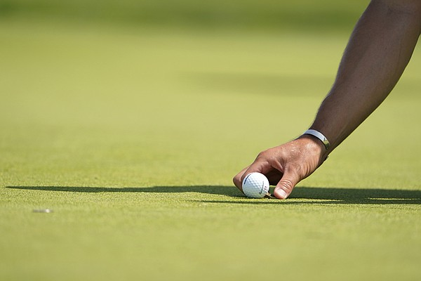 Gary Woodland places his ball on the fifth green during the first round of the U.S. Open Golf Championship, Thursday, June 17, 2021, at Torrey Pines Golf Course in San Diego. (AP Photo/Jae C. Hong)