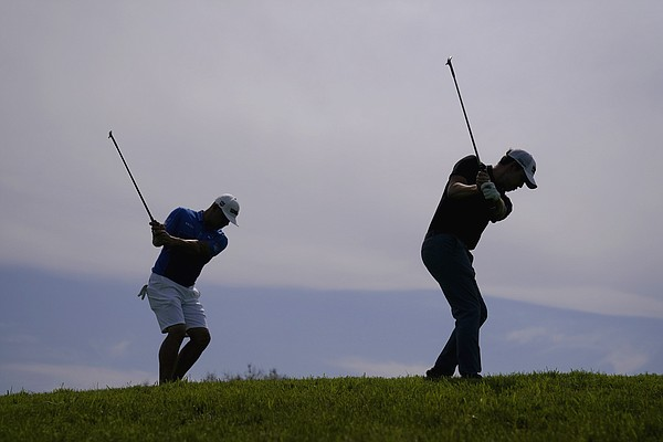Patrick Cantlay, right, and Gary Woodland chip on the 12th green during a practice round of the U.S. Open Golf Championship, Wednesday, June 16, 2021, at Torrey Pines Golf Course in San Diego.