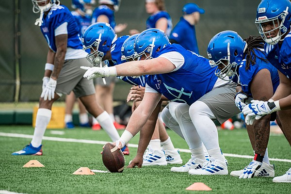 KU center Colin Grunhard calls out an assignment during the first practice of the 2021 season on Aug. 5, 2021.