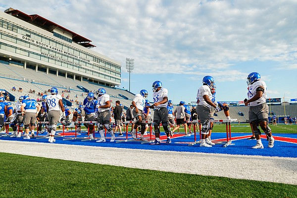Kansas players get stretched out for practice on Saturday, Aug. 14, 2021 at Memorial Stadium.