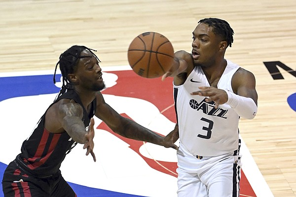 Utah Jazz guard Trent Forrest (3) passes the ball away from Miami Heat guard Marcus Garrett during the first half of an NBA summer league basketball game Friday, Aug. 13, 2021, in Las Vegas.
