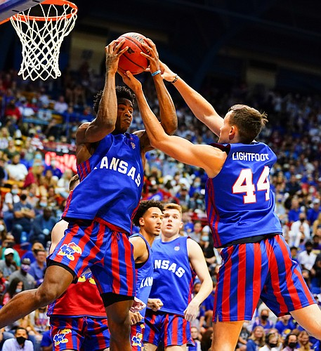 Kansas Jayhawks guard Ochai Agbaji (30) and Kansas Jayhawks forward Mitch Lightfoot (44) come down with a rebound during Late Night in the Phog, Friday, Oct. 1, 2021 at Allen Fieldhouse.