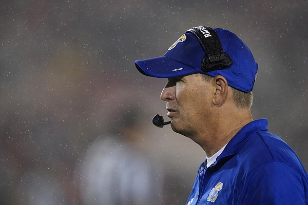 Kansas head coach Lance Leipold walks on the field during the second half of an NCAA college football game against Iowa State, Saturday, Oct. 2, 2021, in Ames, Iowa.