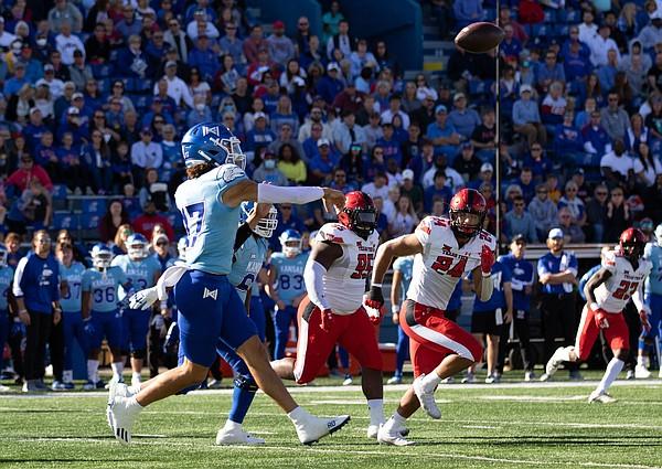 Kansas redshirt junior Jason Bean throws on the run against Texas Tech. Kansas fell 41-14 on Saturday, Oct. 16, 2021.