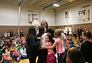 Cara McNorton's 5th-grade class at Kennedy Elementary performs on drums and McNorton ...
