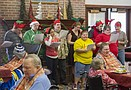 Students in the Community Transition Program (C-TRAN), sing Christmas carols to residents ...