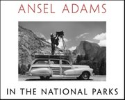 Ansel Adams shown on top of his Ford Woody station wagon around 1941-42 in Yosemite National Park. Adams constructed a mounted platform, where he would perch his large format camera on a tripod and shoot.